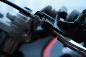 Hur justera Master koppling kabeln på en Honda 125CC