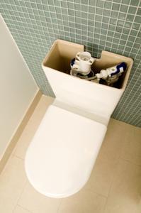Hur att reparera en toalett cistern
