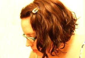 Korta frisyrer för lockigt hår