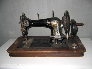 Hur man tråd spindeln på en gammal singer symaskin