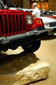 Hur man byter kontroll arm bussningar på en jeep