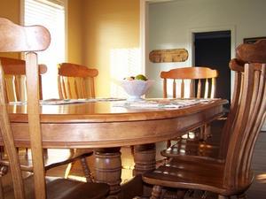 Hur till utsträcka en Oval matbord
