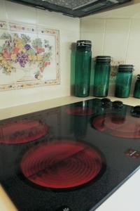Hur att reparera en spishäll med repiga glas