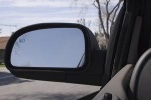 Hur man byter en förarens sida spegel ljus på en Ford F-250