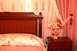 Hur man kan inreda ett sovrum stuga