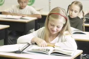 Rollen som en elementär Student i klassrummet