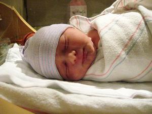 Hur man lindar en baby för bättre sömn