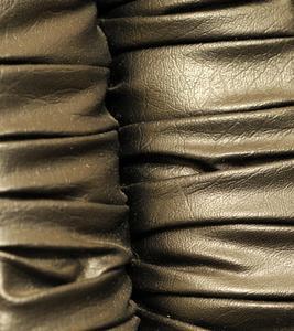 Vad är faux läder tyg?